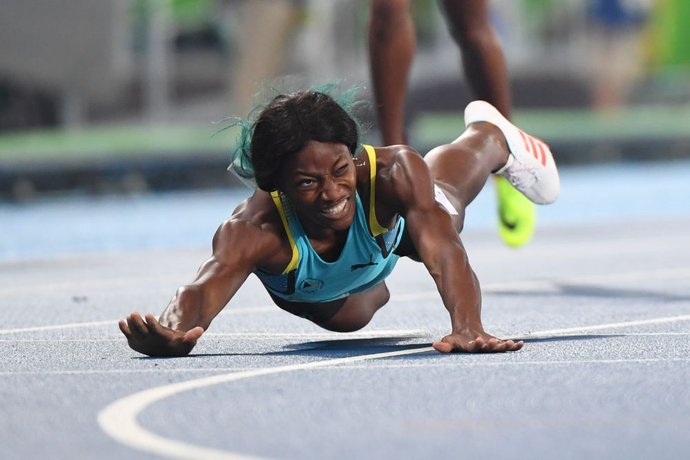 Bahamas's Shaunae Miller crosses the finish line to win the Women's 400m Final during the athletics event at the Rio 2016 Olympic Games at the Olympic Stadium in Rio de Janeiro on August 15, 2016. / AFP PHOTO / OLIVIER MORINOLIVIER MORIN/AFP/Getty Images ORIG FILE ID: AFP_EX9ZT